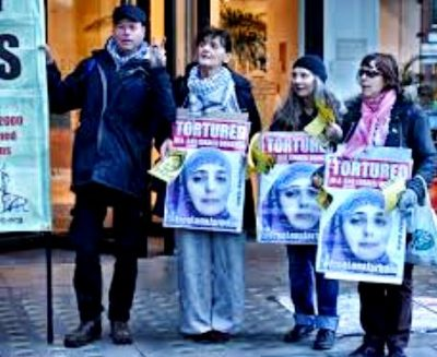 Palestinian women protest U.S.-Israeli genocide including torture of women, children.