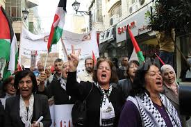 Palestinian women protest Israeli occupation of their land and murders of their people.