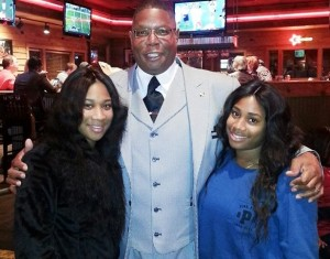 Pastor Kevin Clark, with twin daughters, sisters to Anthony Clark reed.