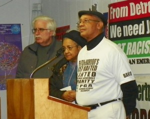 Marian Kramer of MWRO (center), flanked by Dave Sole of Moratorium NOW! and Rev. Pinkney. announces Dec. 6 strategy meeting in Detroit.
