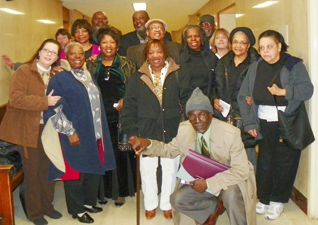 Rev. Pinkney (top) with wife Dorothy in front, and Detroit supporters during 2011 trial regarding the Whirlpool-led move to remove him as President of the local NAACP.