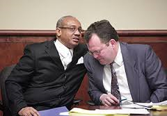 Rev. Pinkney confers with appeals attorney Tim Holloway at earlier court hearing. Photo: Daymon Hartley