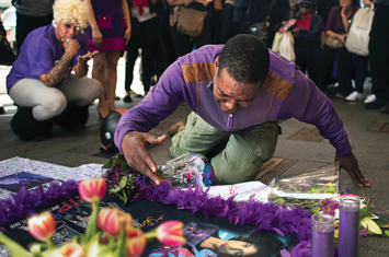 A fan cries at a makeshift memorial created in remembrance of singer Prince outside Apollo Theatre in New York , April 22.