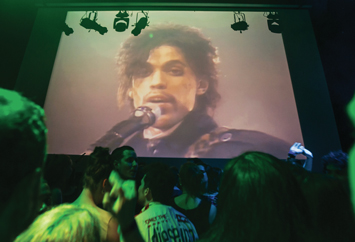 "A crowd pays tribute to Prince inside First Ave where ""Purple Rain"" was filmed late, April 21,in Minneapolis. Photo: AP/Wide World photos"