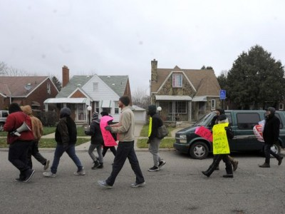 Protesters march down Whitcomb in Detroit after murder of Kevin Matthews, 35, by white Dearborn cop.