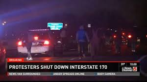 Protesters shut down Interstate 170 the night after Martin was killed.