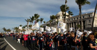 Members of labor unions last year marched past the capitol in San Juan, Puerto Rico against an austerity plan to help the island's debt crisis.