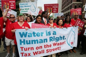 Nurses help lead last years' massive march against water shutoffs in downtown Detroit, July 18, 2014.