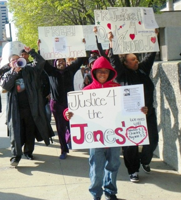 Rafael Jones, 14, leads march for Justice for Aiyana and Charles Jones April 23 2012 at Frank Murphy Hall in downtown Detroit, grandmother Mertilla Jones at left, aunt LaKrystal Sanders at right.