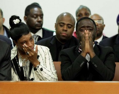 "Ramarley's mother Constance Malcolm and father Franclot Graham weep at press conference. His father sang to him as a baby, ""Ramarley Charley, you are my Charley Ramarley."" His nickname became Charley."