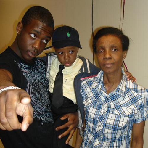 Ramarley Graham, with his little brother and grandmother, who saw white NYC cop Richard Haste shoot him to death in their home in 2012.