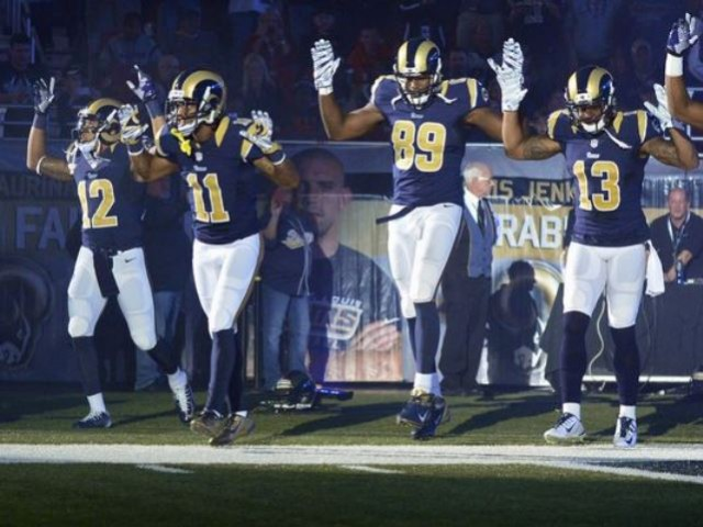 Louis Rams wide receiver Stedman Bailey (12), wide receiver Tavon Austin (11), tight end Jared Cook (89), wide receiver Chris Givens (13) and wide receiver Kenny Britt (81) put their hands up to show support for Michael Brown before a game against the Oakland Raiders at the Edward Jones Dome.(Photo: Jeff Curry, USA TODAY Sports)