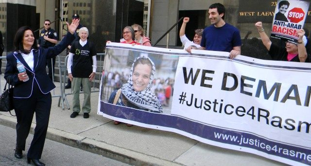 Rasmea Odeh greets and thanks supporters as she leaves court June 13, 2016.