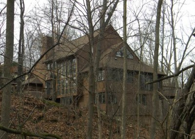 Rhodes' house, at 1610 Arborview Blvd. is hidden in the backwoods behind working-class homes near Ann Arbor. According to Zillow, it is worth over $600.000. Rhodes doesn't have to worry about foreclosure!