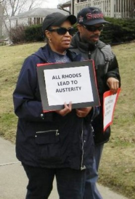 Richard Clay (r) marches with Jan Frazier at Rhodes protest March 12, 2016.