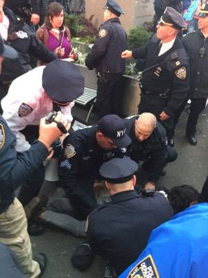 Police mob protester as arrest is made. Photo: George Joseph