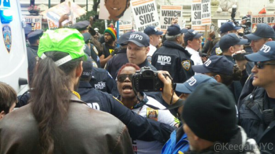 First arrest by NYPD, Twitter photo by Keegan Stephan