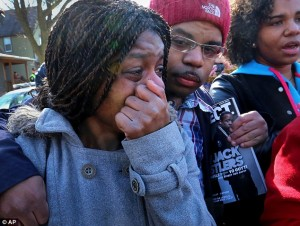 Protester weeps as demonstrations continued over the weekend,