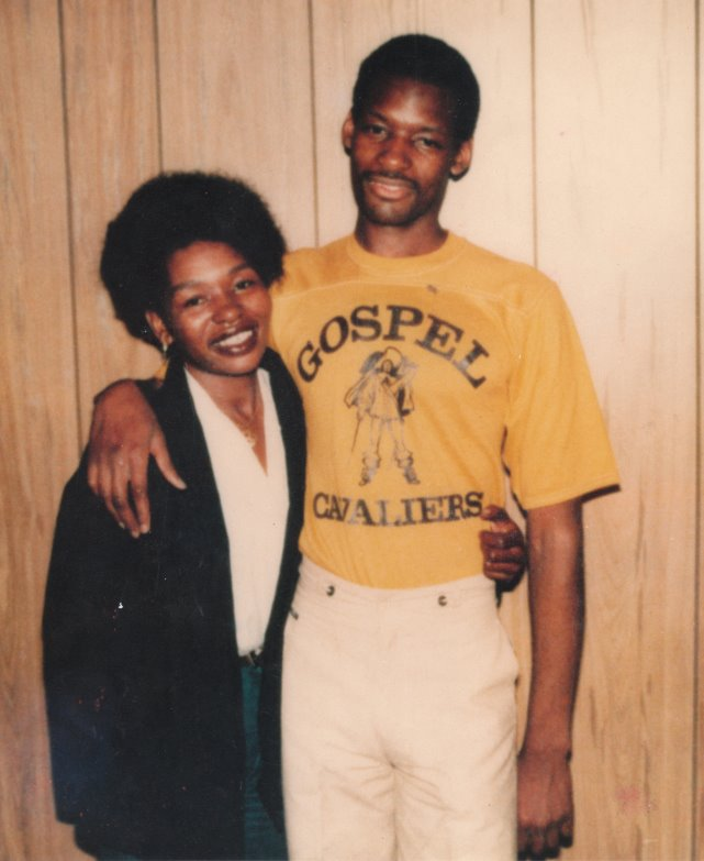 "Rosie Lewis with her son Charles Lewis in 1977, shortly after his incarceration. He is wearing a T-shirt from a prison band called ""The Gospel Cavaliers."""
