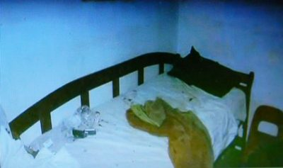 The bed under which Valerie Glover hid. (Photos from Worthy press conference.)