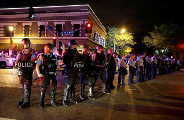 St. Louise police in riot gear line up to block protesters October 9, 2014. AP