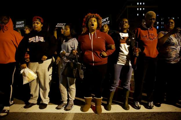 Marchers in St. Louis block street in a second night of protests over police killing of Vonderrit Myers, 18.