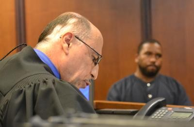 Black defendant (right)being arraigned by 19th District Judge Sam Salamey Photo by Joe Slezak