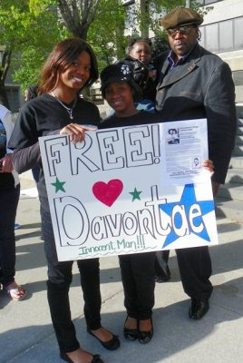 Jermaine Tilmon with his stepdaughters during rally April 23, 2012.