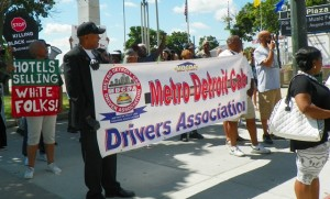 Kenneth  leads march with cab drivers' banner.