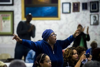 Flint resident Barbara Griffith-Wilson screams out an amen as she stands up out of her seat to show solidarity with a number of Flint City Council members that speak their minds during a call for the removal of Emergency Manager Darnell Earley on Monday, Oct. 6, 2014 at Antioch Missionary Baptist Church in Flint. Jake May | MLive.com
