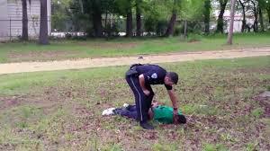 Killer cop Slager stands over Walter Scott's body after he killed him.