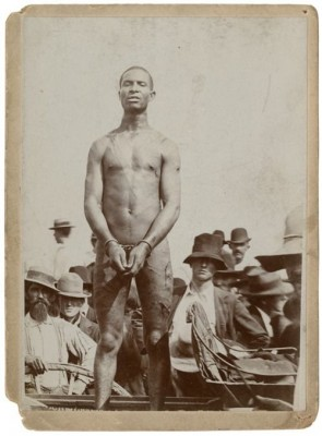 "Photo of slave auction attended by southern ""gentlemen."""