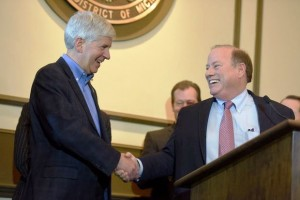 Michigan Gov. Rick Snyder and Detroit Mayor Mike Duggan congratulate each other on bankruptcy approval.