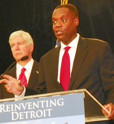 Detroit's former EM Kevyn Orr with Michigan Gov. Rick Snyder at side announces plan for bankruptcy which has destroyed Detroit, on July 19, 2013.