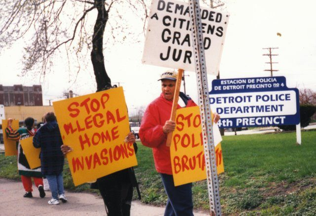 "Cornell Squires (r) and supporters of his son and young cousins who had been framed up by ""Robocop"" William Melendez march on Detroit's old 4th Precinct in 2000. This was 3 years before the feds charged Melendez and 17 other cops with running a Ramparts-style ring that terrorized the southwest side. Squires' son was falsely accused of attempted carjacking; his young cousins' home was invaded by Detroit police who planted drugs there. Squires himself was previously assaulted by Detroit cop Robert Feld, a beating which Squires father Eugene Squires and mother Vester Squires stopped.His father had a heart attack which later proved fatal."