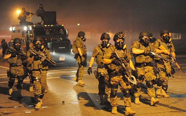 St. Louis County police advance on protesters of Michael Brown