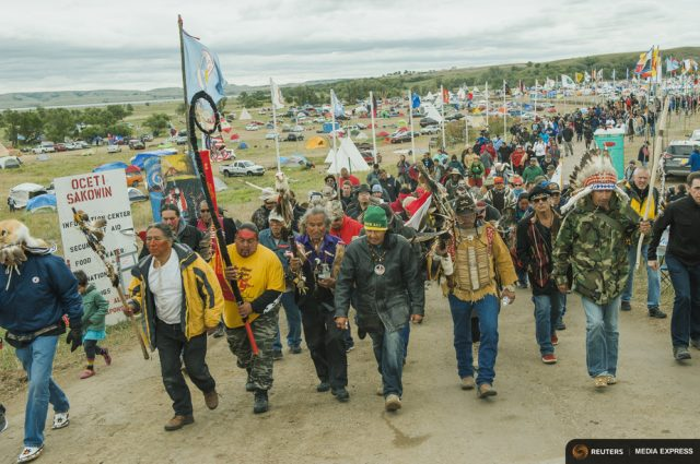 Protesters demonstrate against the Energy Transfer Partners' Dakota Access oil pipeline near the Standing Rock Sioux reservation in Cannon Ball, North Dakota. REUTERS/Andrew Cullen