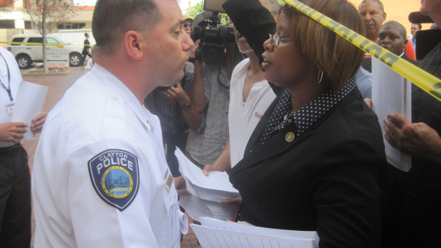 State Sen. Jamilah Nasheed jostled with police as she attempted to deliver petitions in August, calling for a special prosecutor in the case of Michael Brown, killed by Ferguson police Aug. 9, 2014.