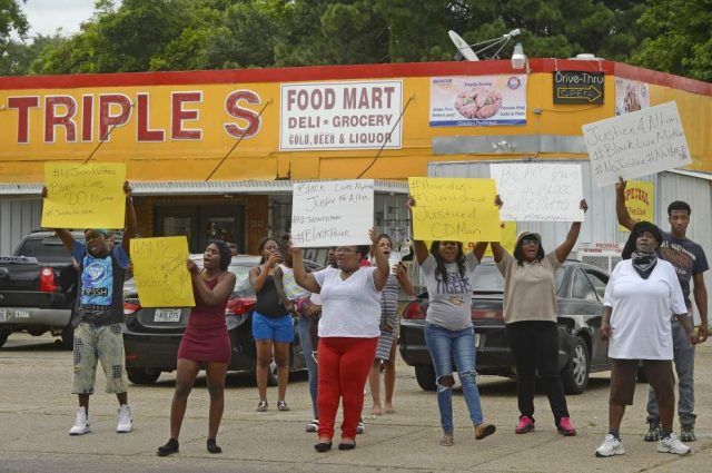 Friends and family protest outside store where cops killed Sterling. Photo: The Advocate