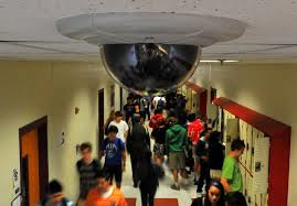 Surveillance camera in school hallway.