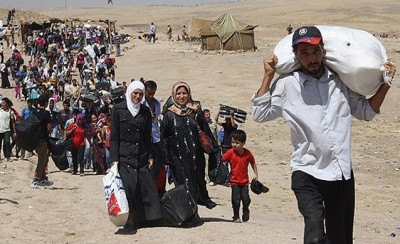 Syrian civilian refugees fleeing ISIS-led attacks.