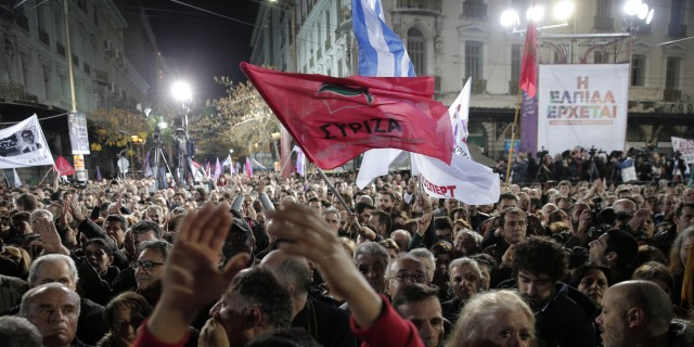 Did Greeks want MORE austerity measures when they voted Tsiparas in? Supporters of Alexis Tsipras, leader of Greece's Syriza left-wing main opposition party attend his pre-election speech at Omonia Square in Athens Thursday, Jan. 22, 2015. . (AP Photo/Lefteris Pitarakis)