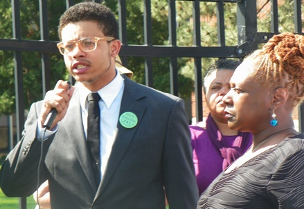 Easterling of the Coalition for Black Struggle, wearing green button for Terrance Kellom, addresses rally.