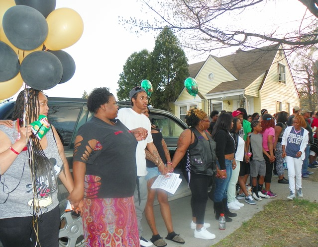 Family members and friends held hands in a large circle that surrounded both front yards.
