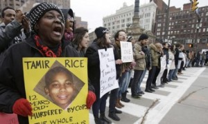 Protest against Cleveland police murder of 12-year-old Tamir Rice last year.