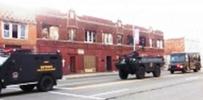 Police swat tanks roll down Linwood to kidnap Ariana from her mother in their home June 24, 2011.