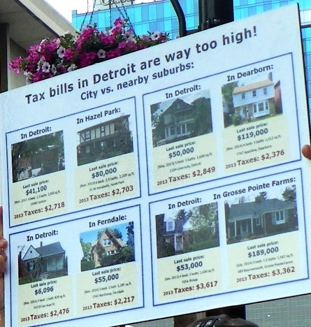 Tax bills in Detroit way too high; poster compares home values and taxes in Detroit and suburbs.