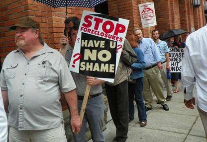 Have you no shame? protesters ask Treasurer, county officials.