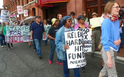 DAREA members participate in tax foreclosure protest outside Register of Deeds office.