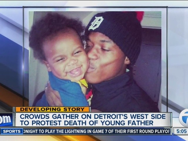 Terrance Kellom, 19, with baby son. He also has a daughter on the way, who he will never see due to his execution by police.